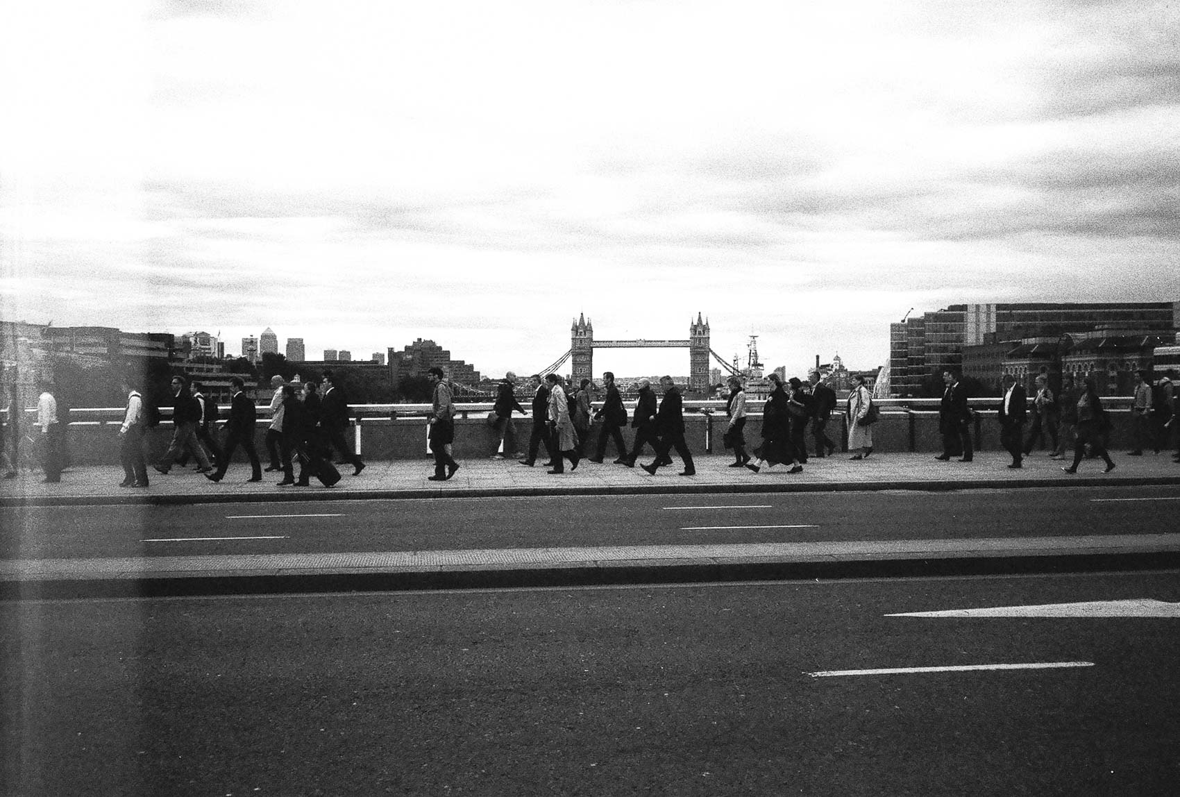 us and them | people crossing london bridge