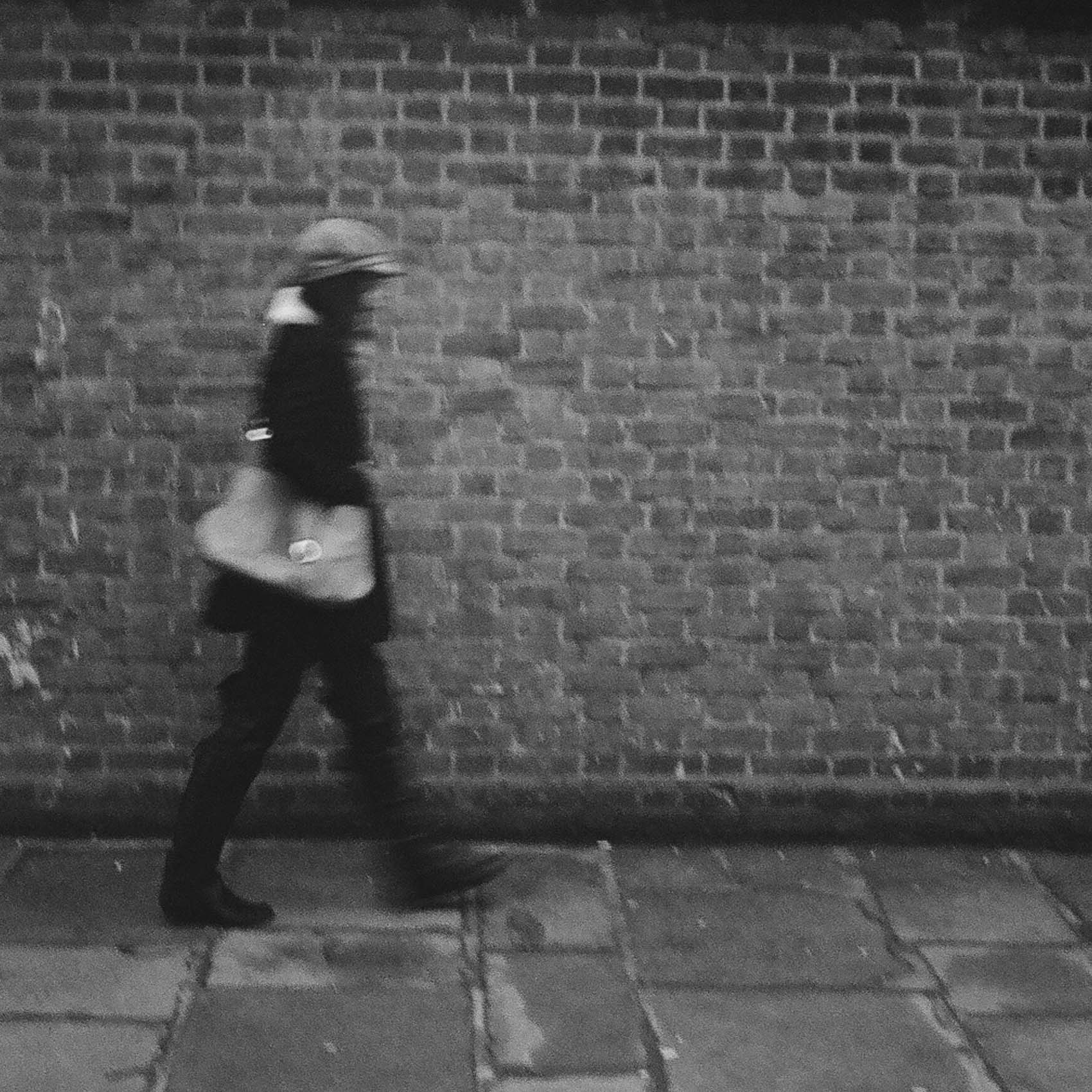 don't waste your film | girl walking by the brick wall